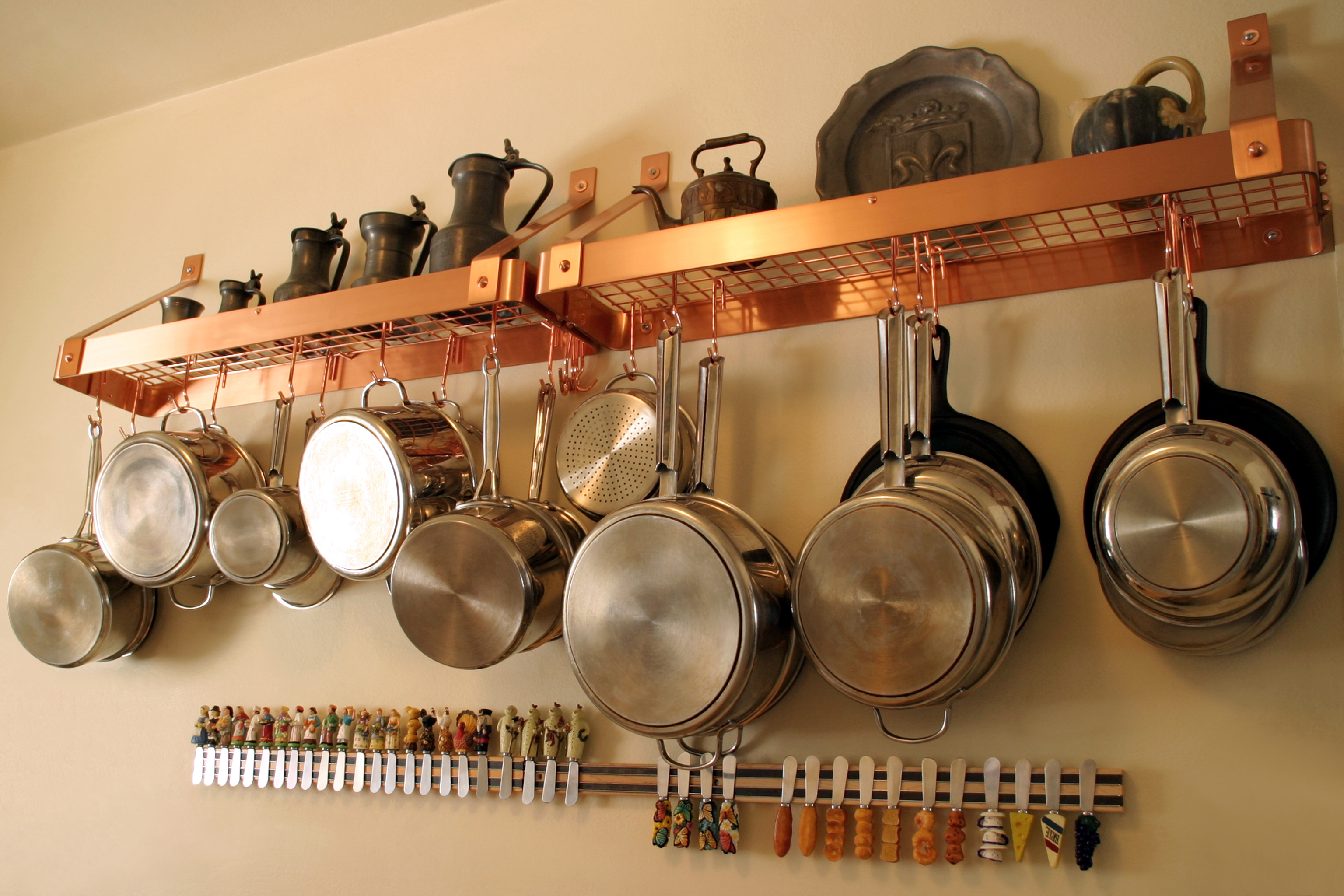 Maximum kitchen space by hanging pots and pans on the wall